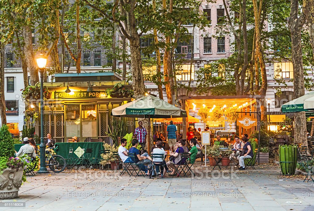 people enjoy the evening at Bryant Park stock photo