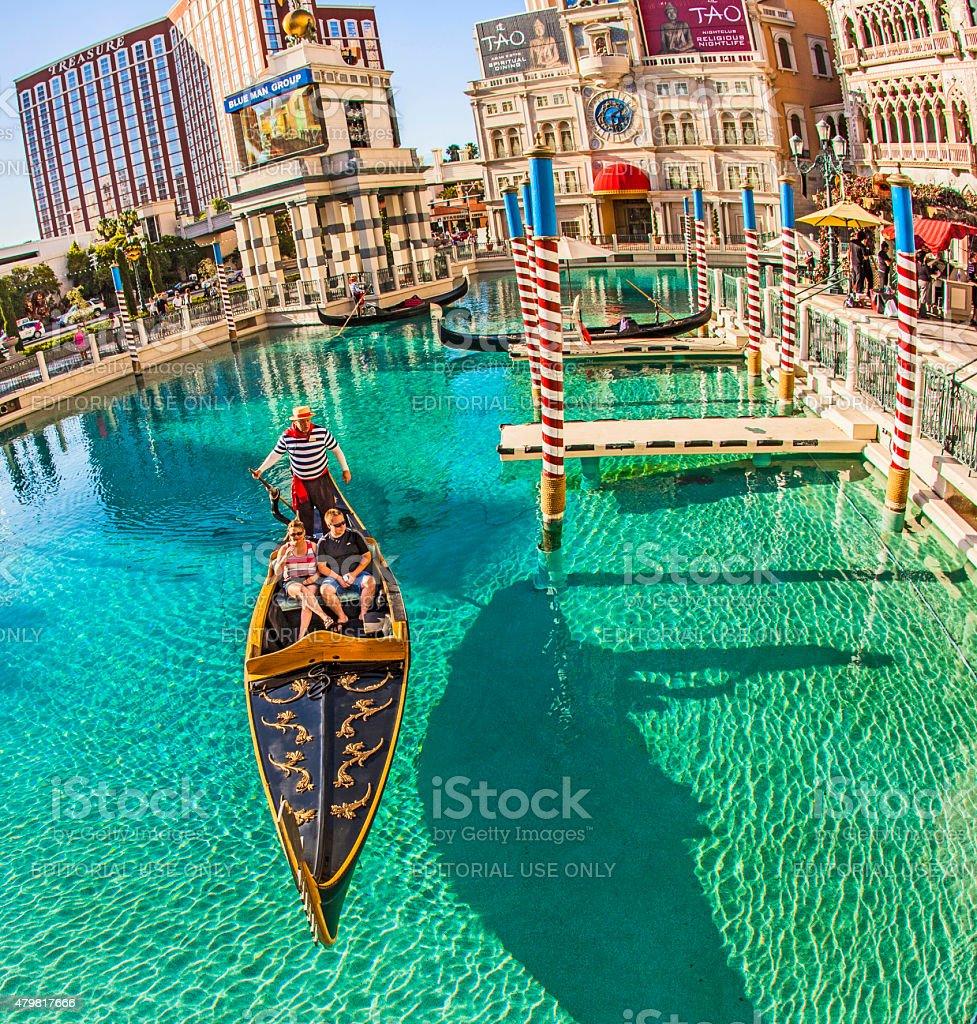 people enjoy the gondola at Venetian Resort Hotel stock photo