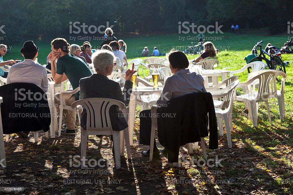 people enjoy the last warm day stock photo