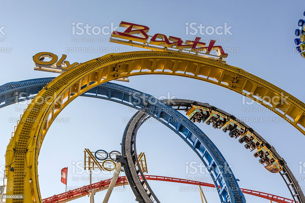 people enjoy the roller coaster at Hamburg Dom stock photo