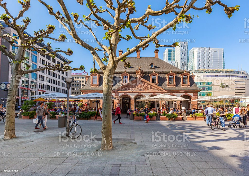 people enjoy the sunny day in Frankfurt at cafe Hauptwache stock photo