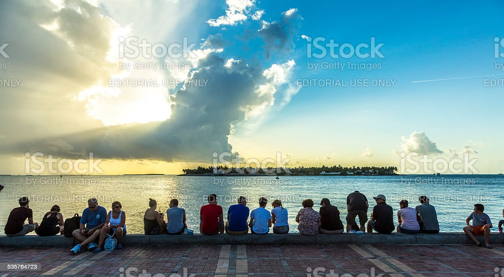 people enjoy the sunset point at Mallory square stock photo