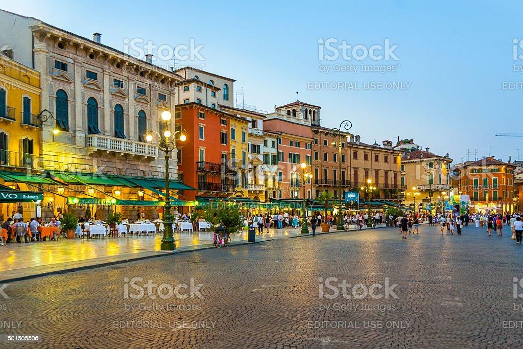 people enjoy walking at Piazza Bra stock photo