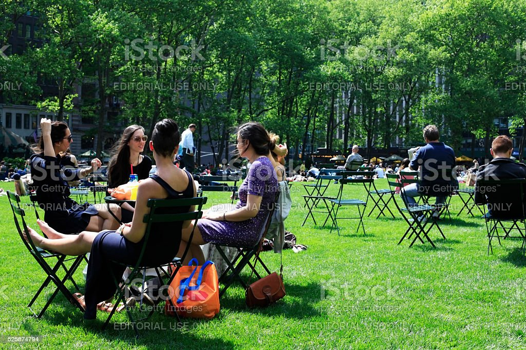 People enjoying a nice day in Bryant Park stock photo