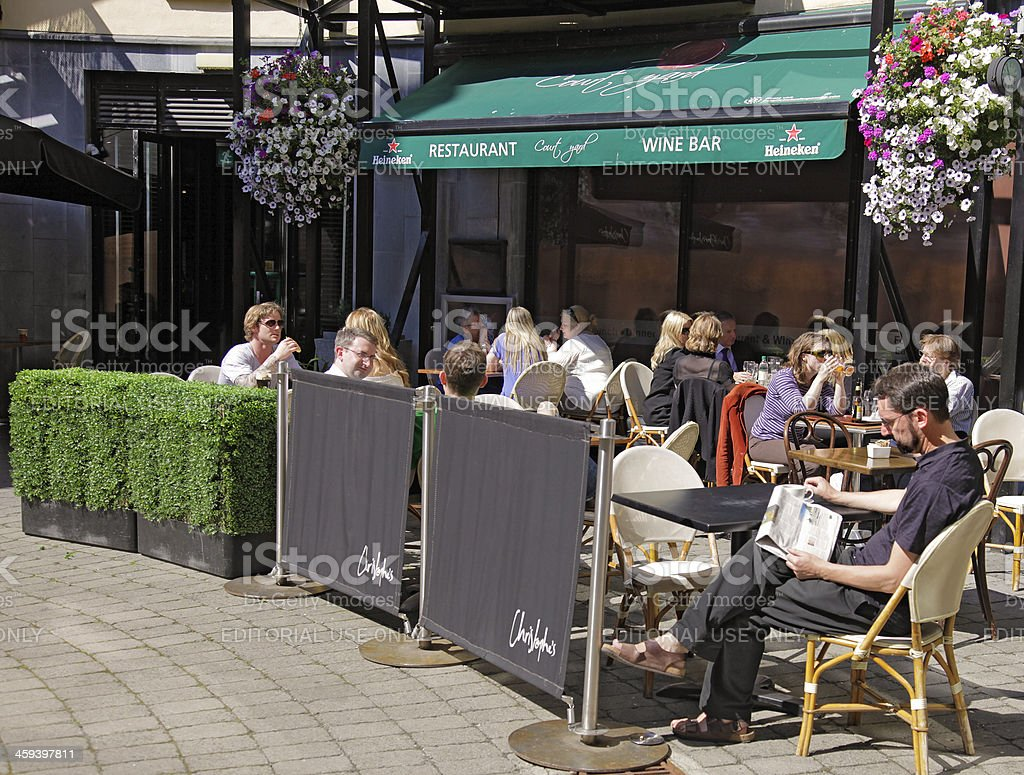 People enjoying a pleasant afternoon; Dublin wine bar stock photo