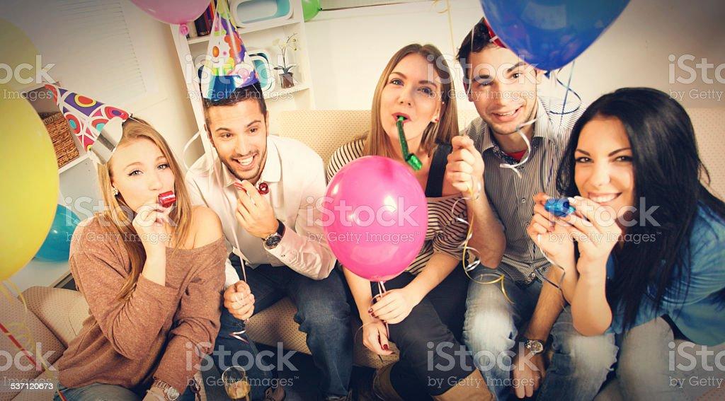 People enjoying birthday party. stock photo