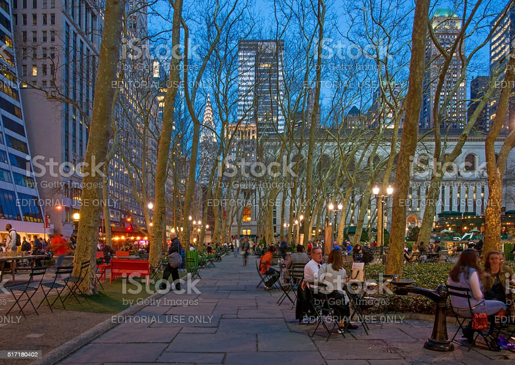 People Enjoying Bryant Park at a Spring Dusk stock photo