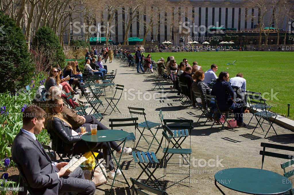 People Enjoying Bryant Park on a Sunny Early Spring Day stock photo