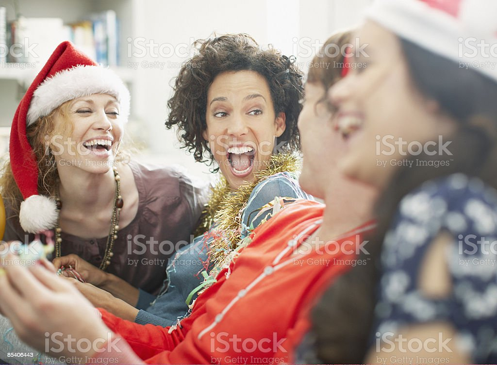 People enjoying Christmas party stock photo