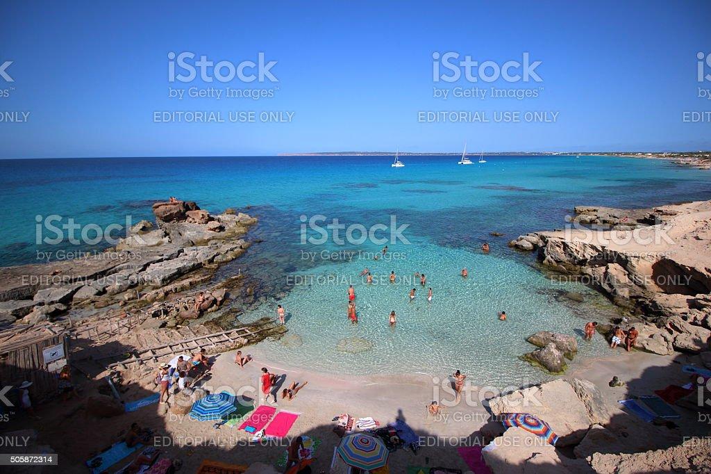 People enjoying Escalo d'es Mort beach in Formentera. stock photo