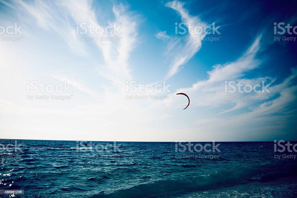 People enjoying kitesurfing on clear blue tropical water stock photo