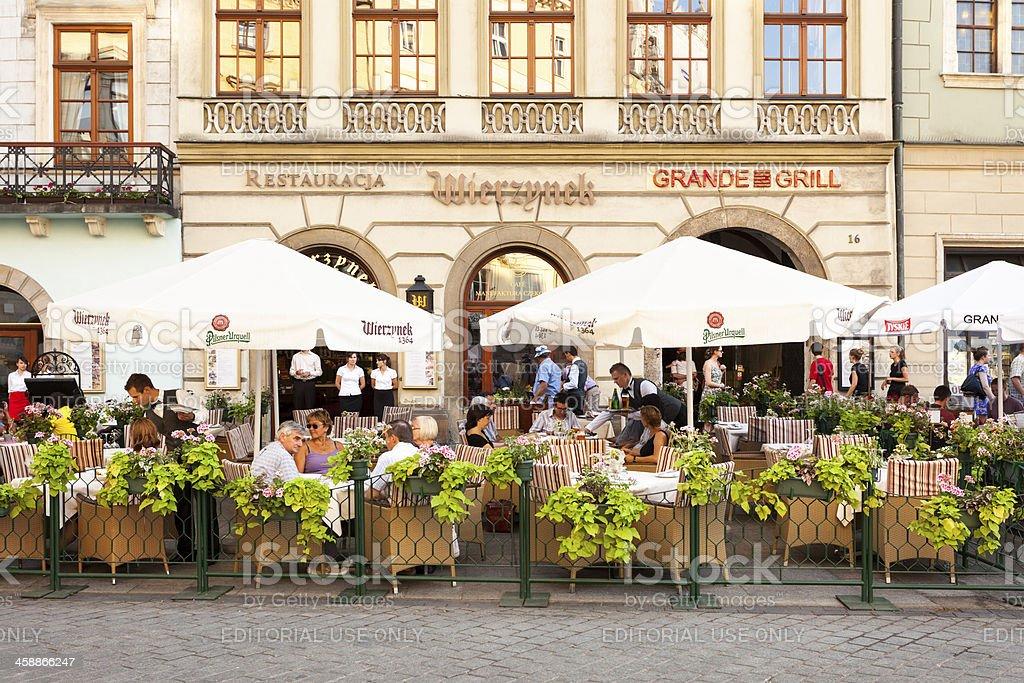 People Enjoying Lunch Break in Restaurant Wierzynek, Cracow, Poland royalty-free stock photo