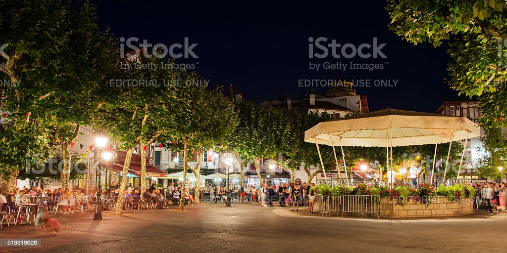 People enjoying music on Place Louis XIV at night stock photo