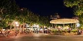 People enjoying music on Place Louis XIV at night