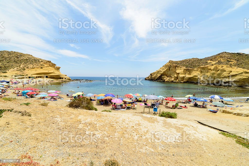 People enjoying on the beautiful cove of Los Cocedores stock photo