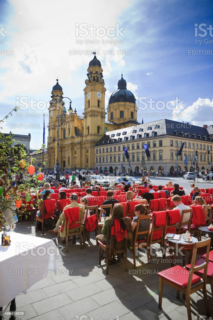 People enjoying sun in Cafe Tambosi, Odeonsplatz, Munich stock photo