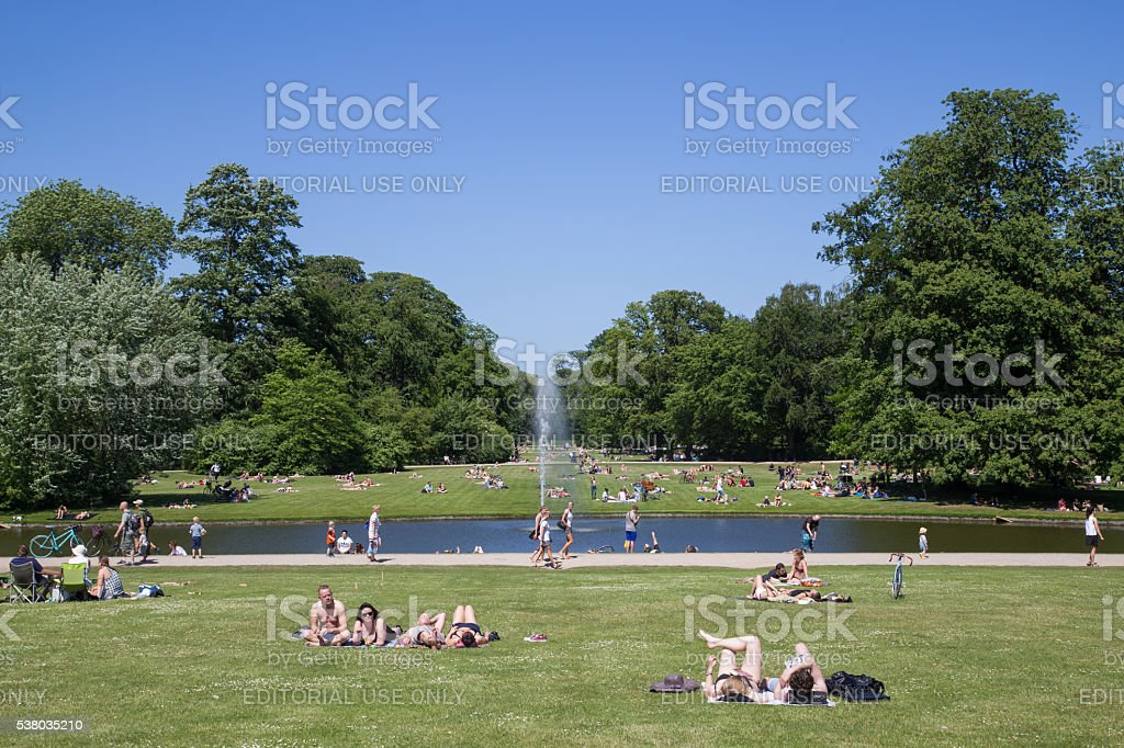 People enjoying Sunday afternoon in a park stock photo