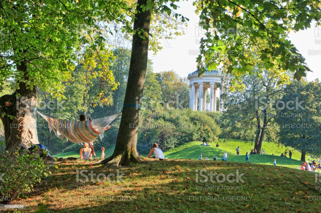 People enjoying the autumn sun in English Garden, Munich royalty-free stock photo