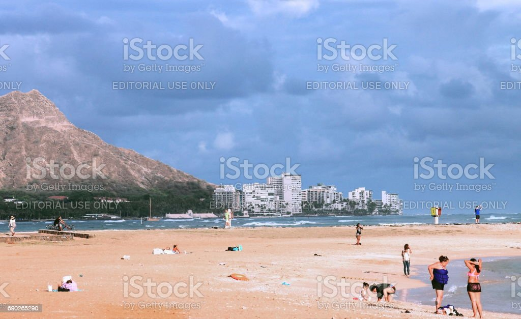 People Enjoying the Beach at Ala Moana stock photo