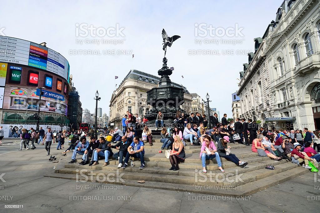People enjoying the sun at Piccadilly Circus London stock photo