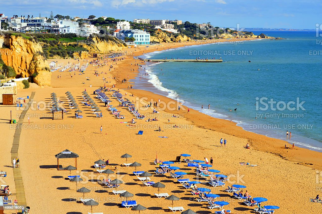 People enjoying the sun on Albufeira Beach stock photo