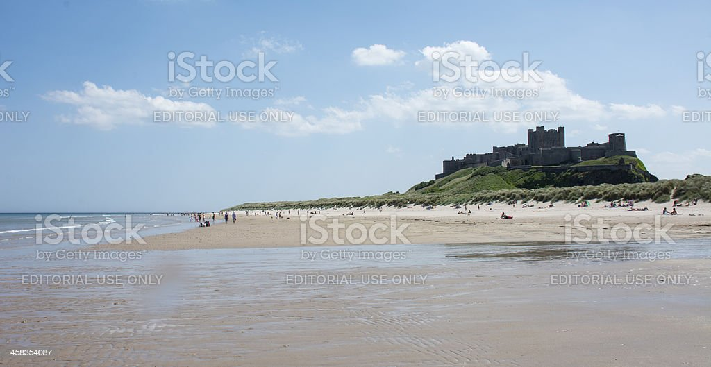 People enjoying the sunshine at Bamburgh stock photo
