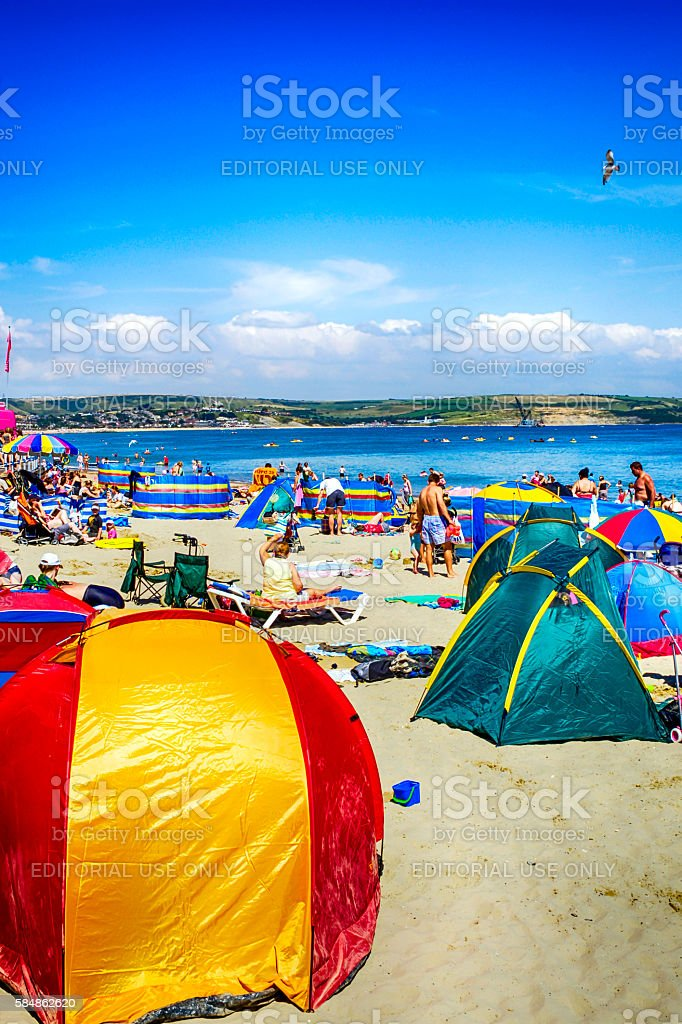 People enjoying their vacation on Weymouth beach, UK stock photo