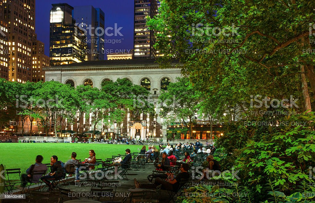 People Enjoying Well Lit Bryant Park in a Spring Evening stock photo