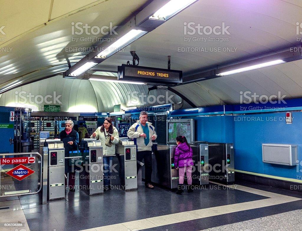People entering Madrid metro station, Spain stock photo