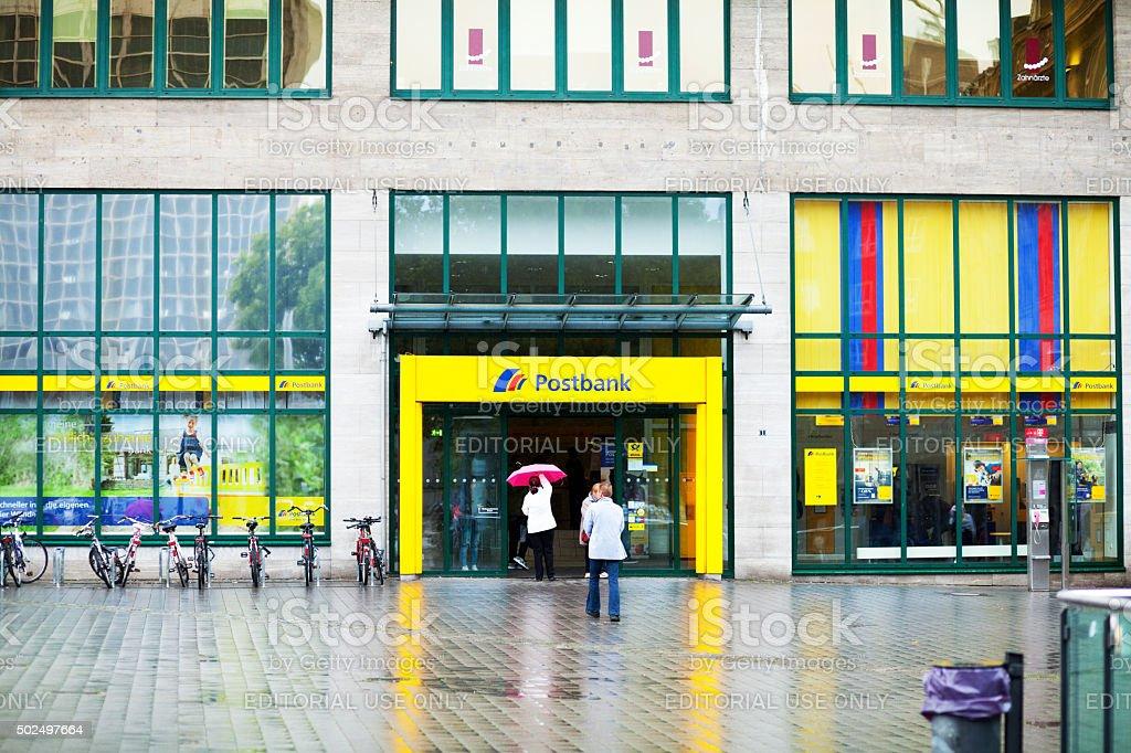 People entering Postbank in Essen stock photo
