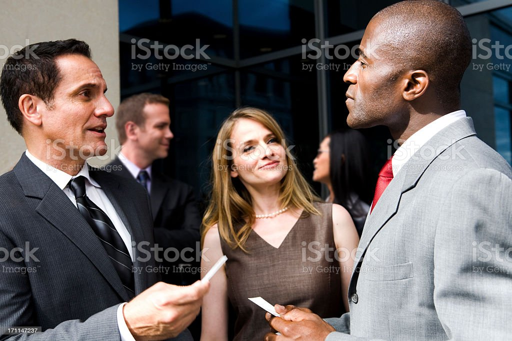 People exchanging business cards stock photo