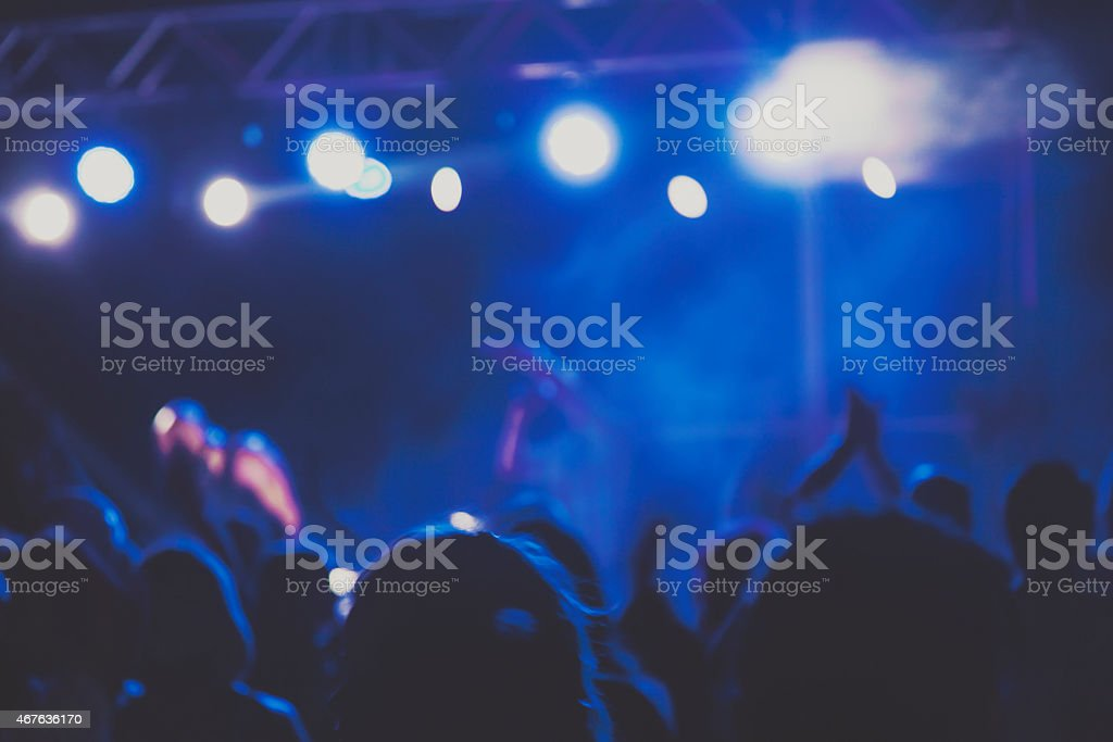Concert party background with abstract light border made of human...