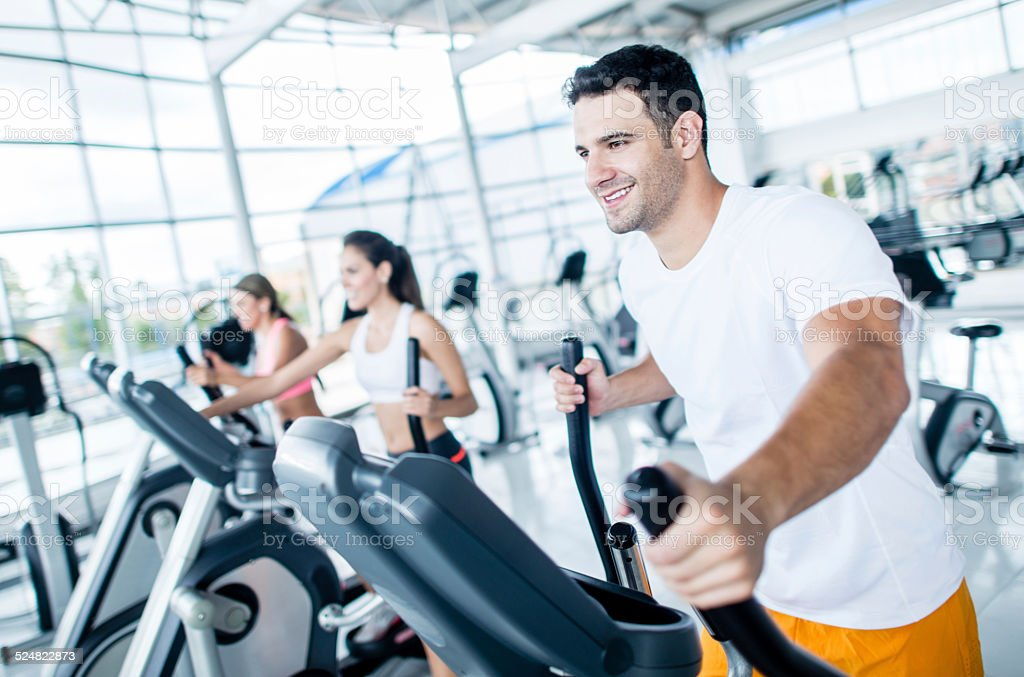 People exercising at the gym stock photo