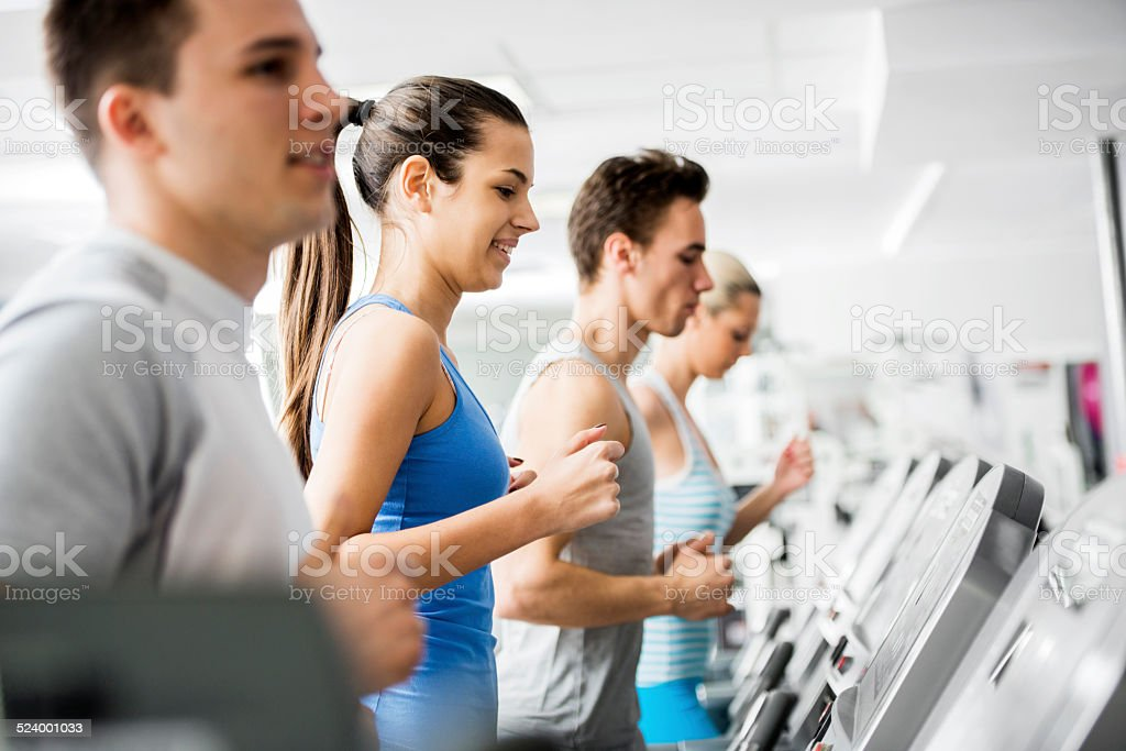 People exercising in a gym. stock photo