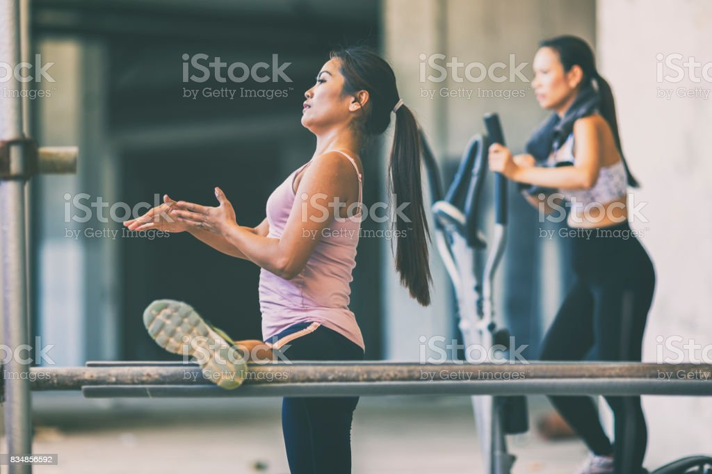 People exercising in an urban gym stock photo