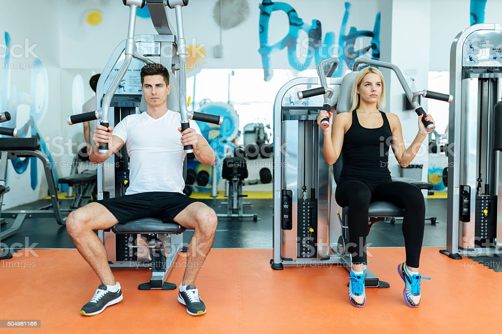 People exercising in gym stock photo
