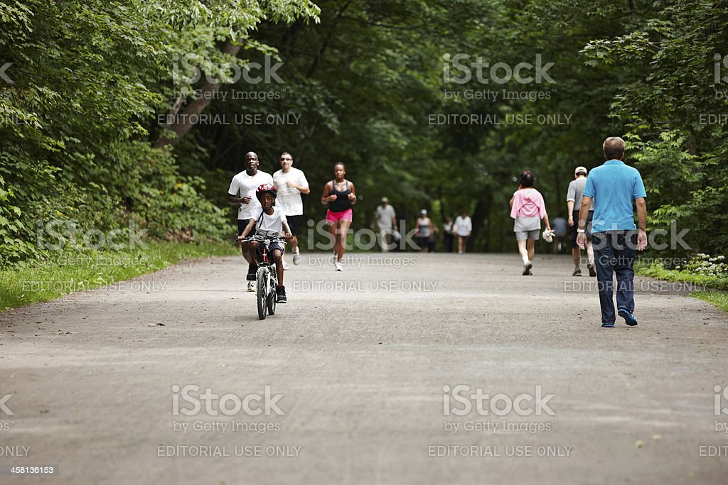 People exercising in Montreal park royalty-free stock photo