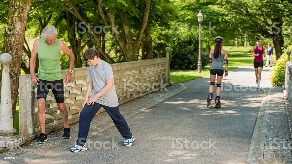 People exercising in park stock photo