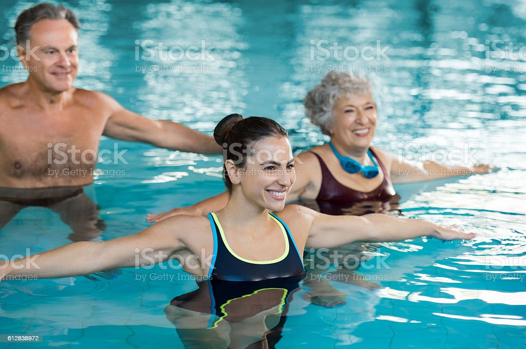 People exercising in pool stock photo