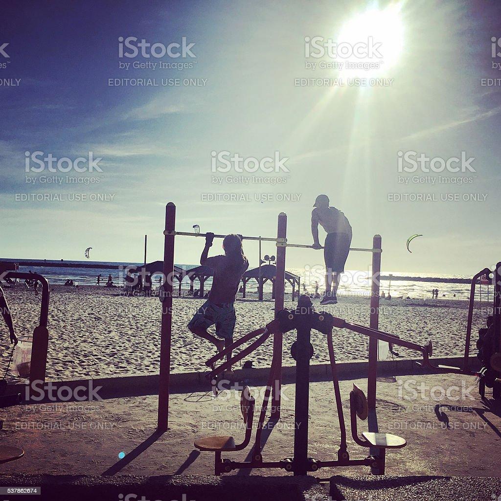 People exercising on Tel Aviv Beach, Israel stock photo