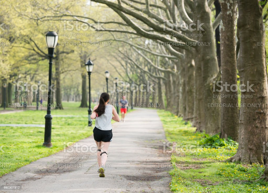 People Exercising Outdoors on Running Path Riverside Park NYC stock photo