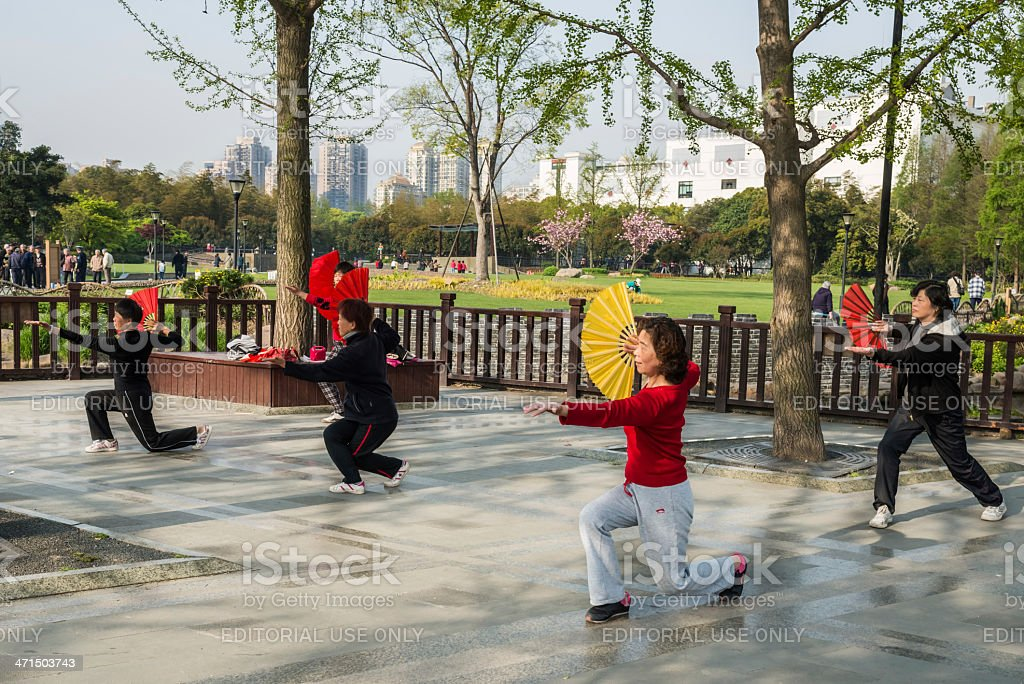 people exercising tai chi with fan gucheng park shanghai china stock photo