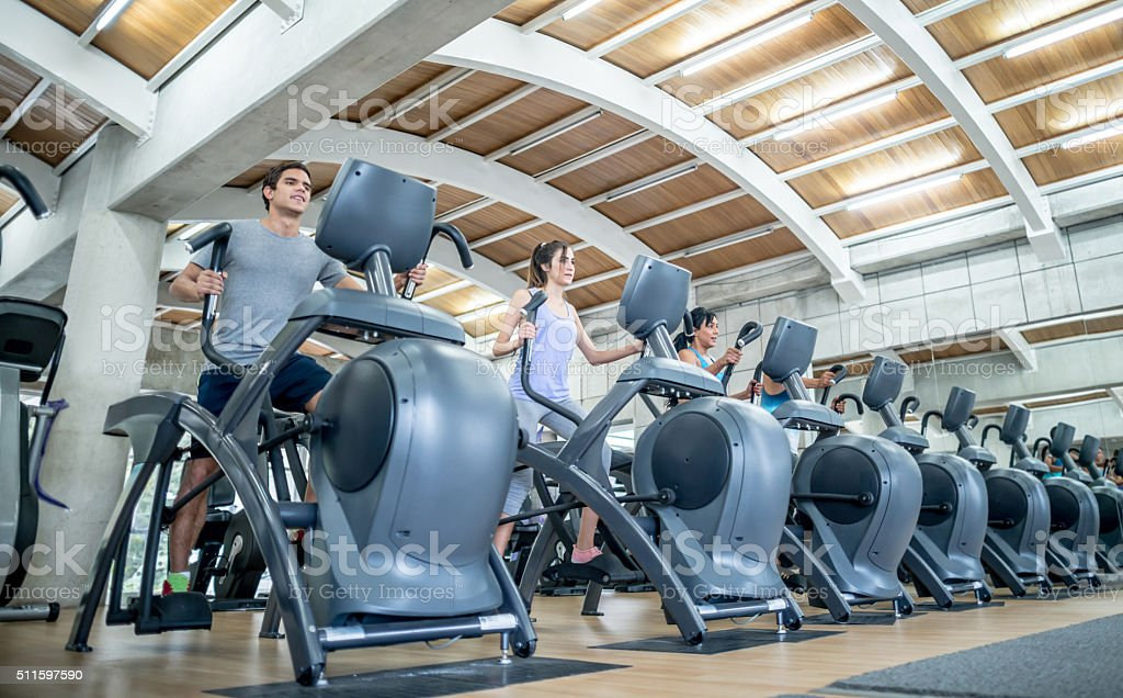 People exericising at the gym stock photo