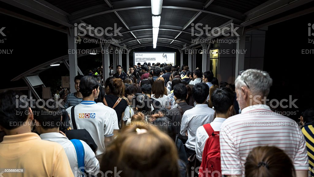 people exit BTS Mo Chit station at night stock photo