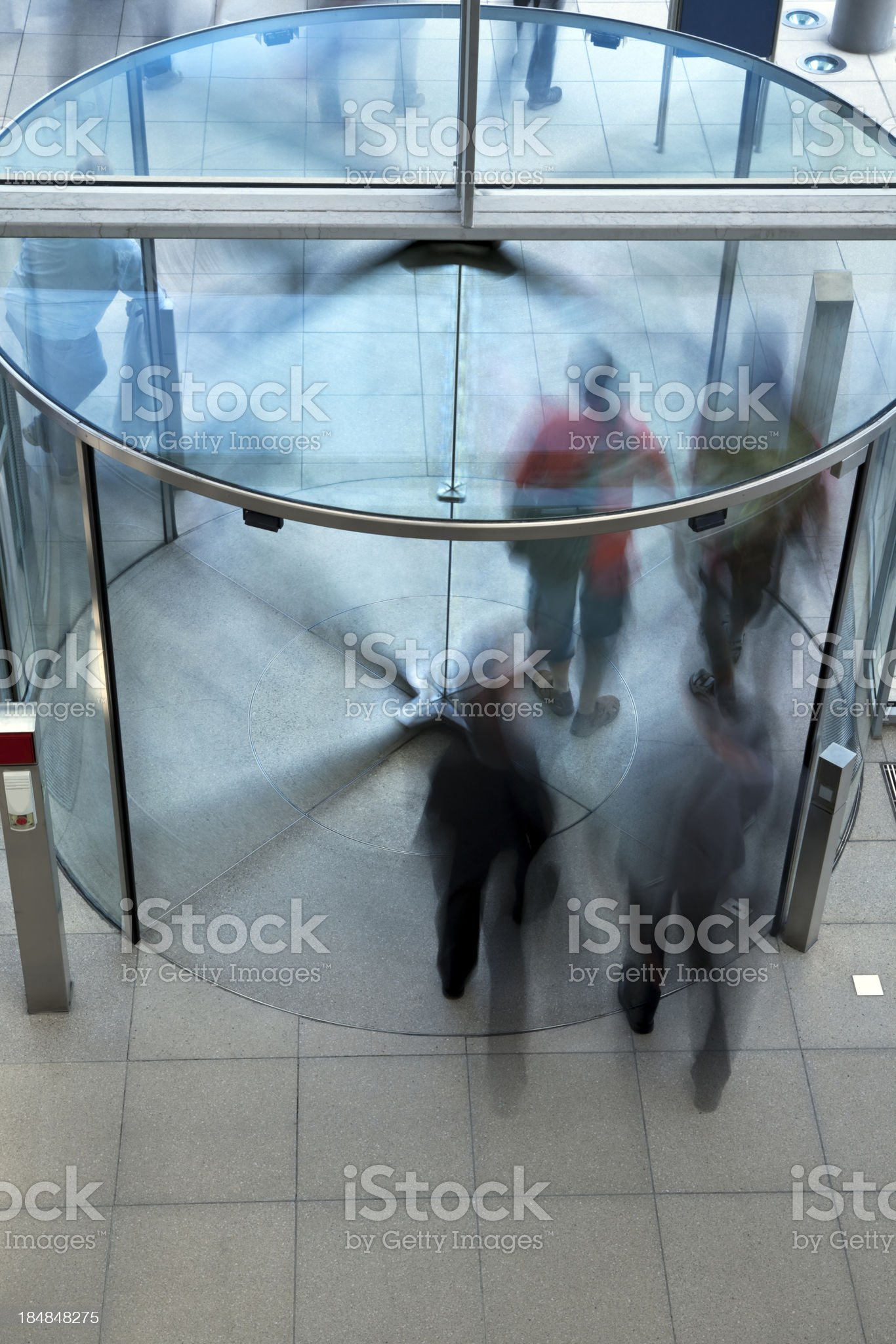 People Exiting Building Through Revolving Door royalty-free stock photo