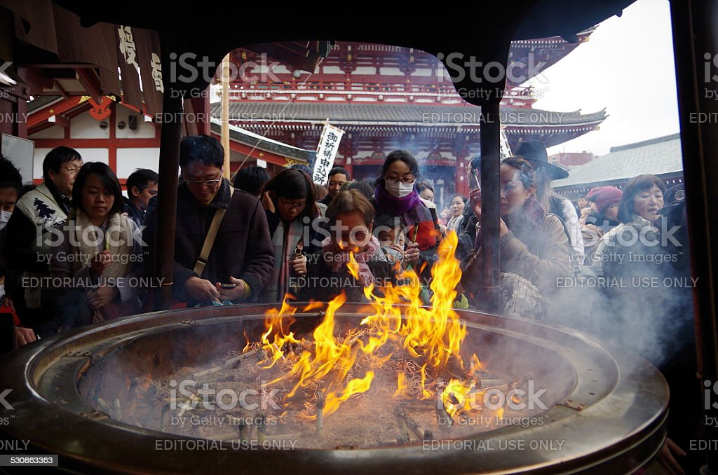 People exposed to the smoke of incense burner stock photo