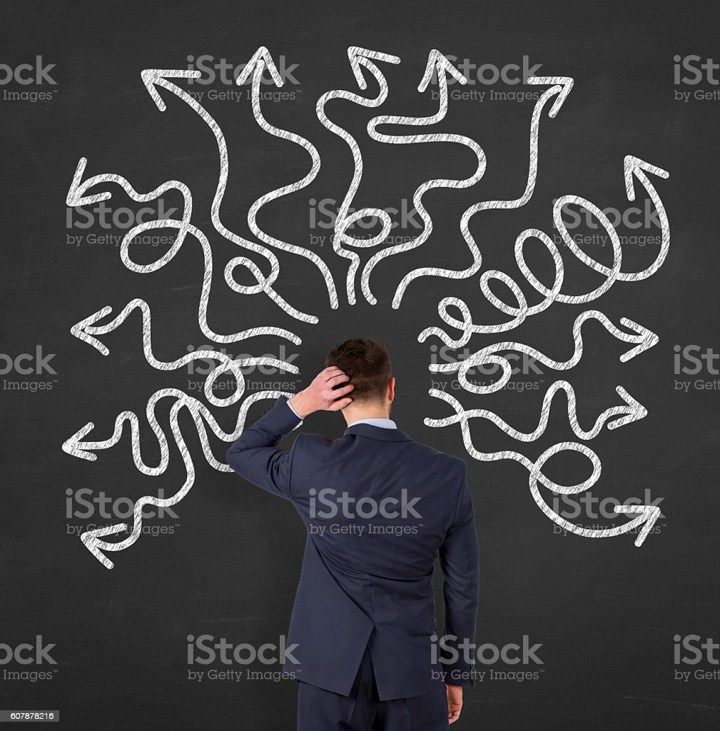 People feeling confusion and chaos on blackboard stock photo