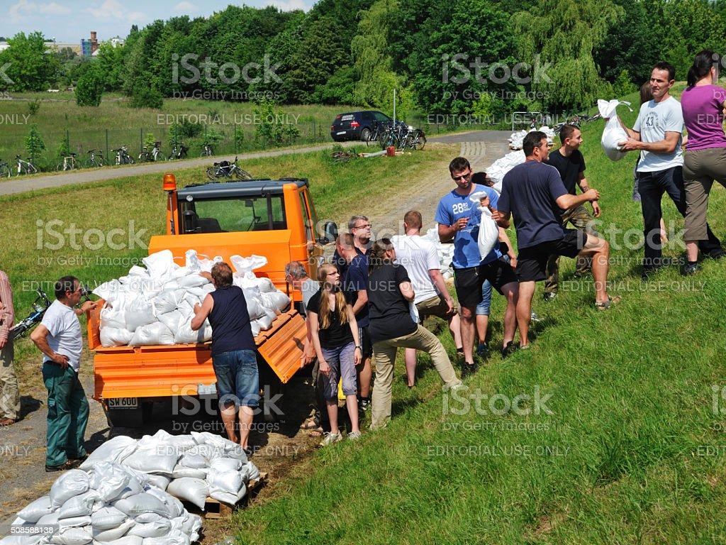 people fighting flood water stock photo