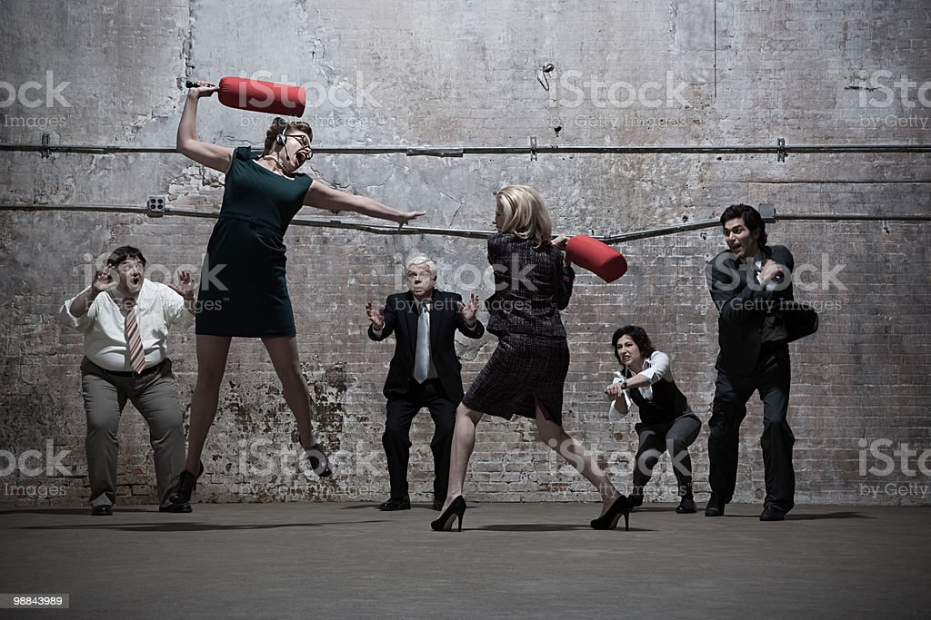 People fighting in warehouse stock photo