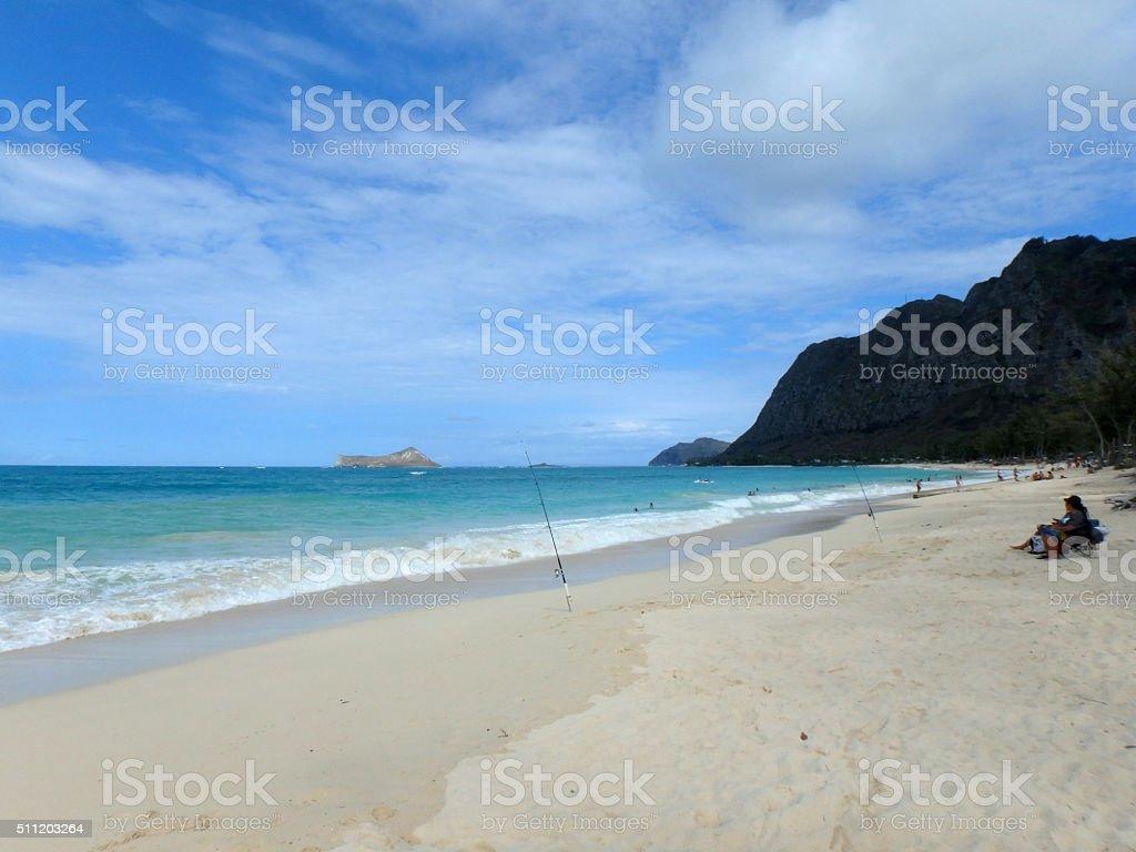 People Fish and Play on Waimanalo Beach stock photo